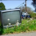 Old TV sitting in weeds - Search Influence