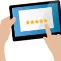 Graphic of a hand using a tablet to read online reviews of a business